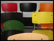 buisframe stoel hout zit en rug